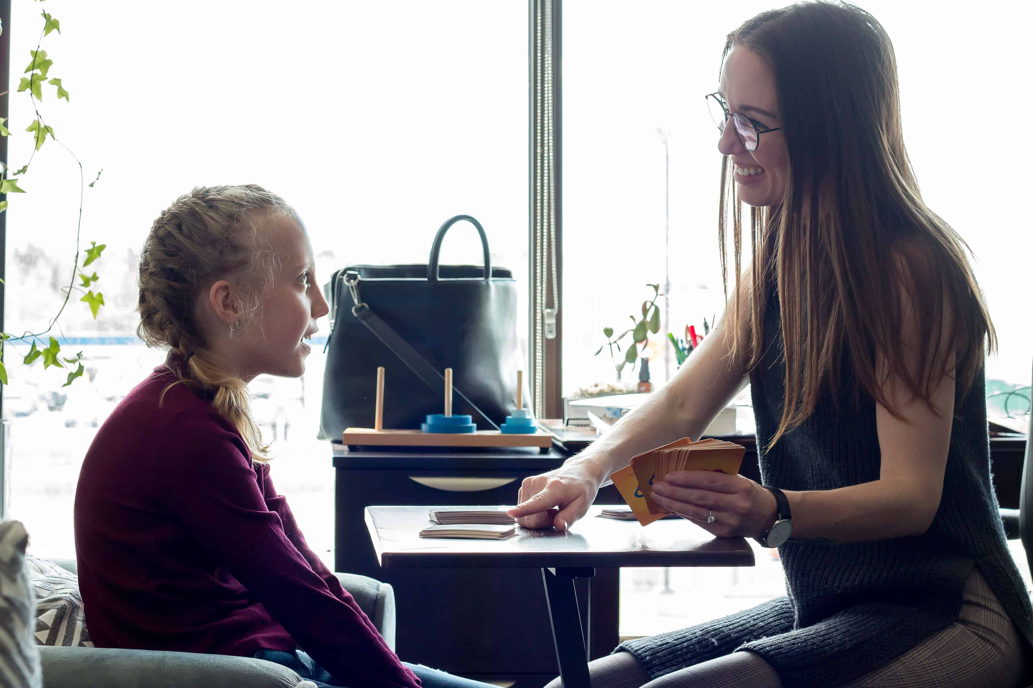 Therapist working with child during therapy session