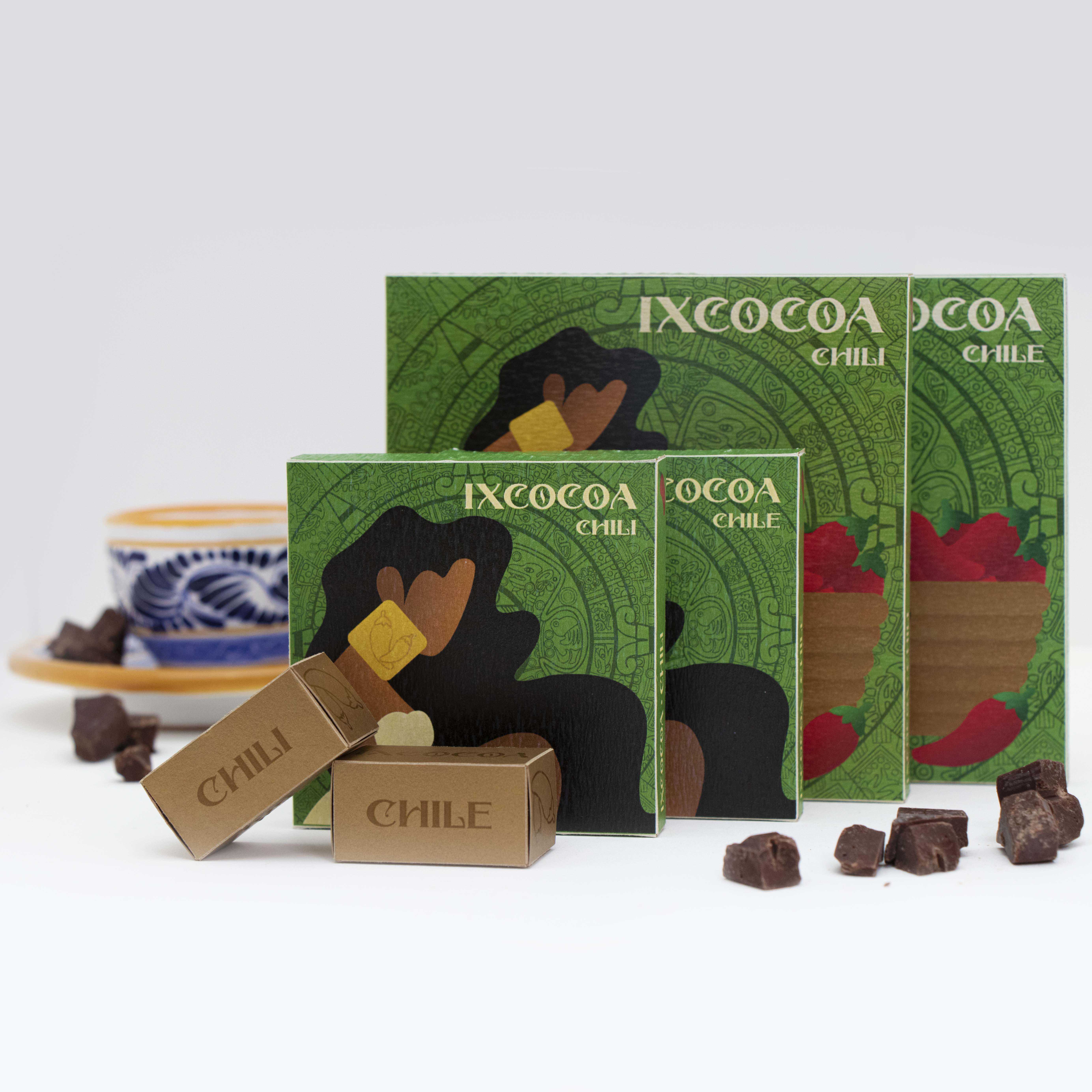 The box that contains the chocolate bars looks like a pyramid because of the influence that the Mayan architecture has on the Ixcocoa brand. Additionally, its aesthetic is completely white with all the visuals and necessary information engraved on the box. The engraving is a reference to the archaeological details and  intricate carving found in Mayan sculptures from their time.