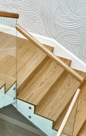 Custom handrails on a wooden internal staircase