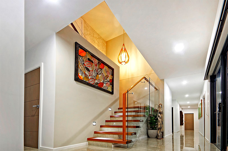 Internal staircase with handrails and glass balustrades