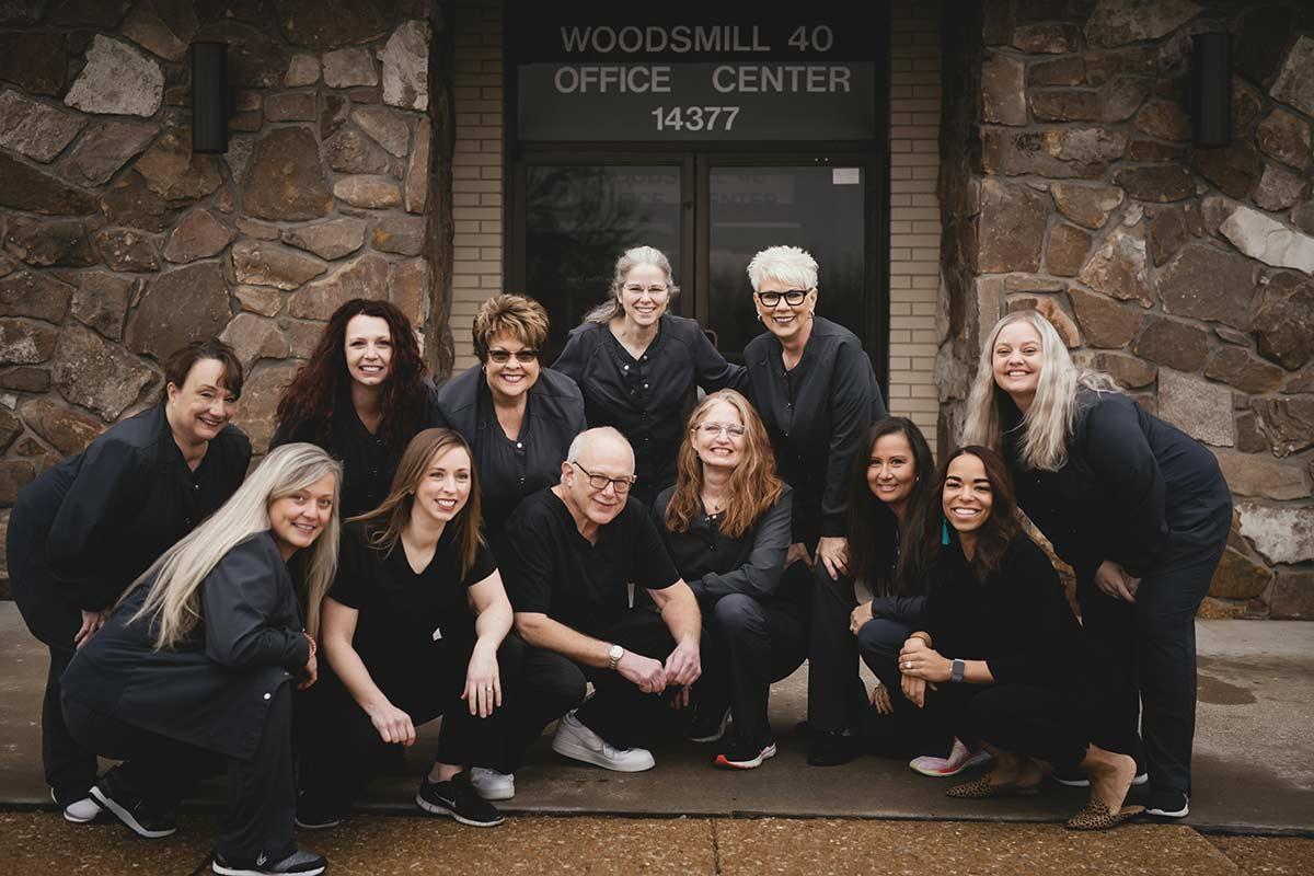 team members in front of dental office
