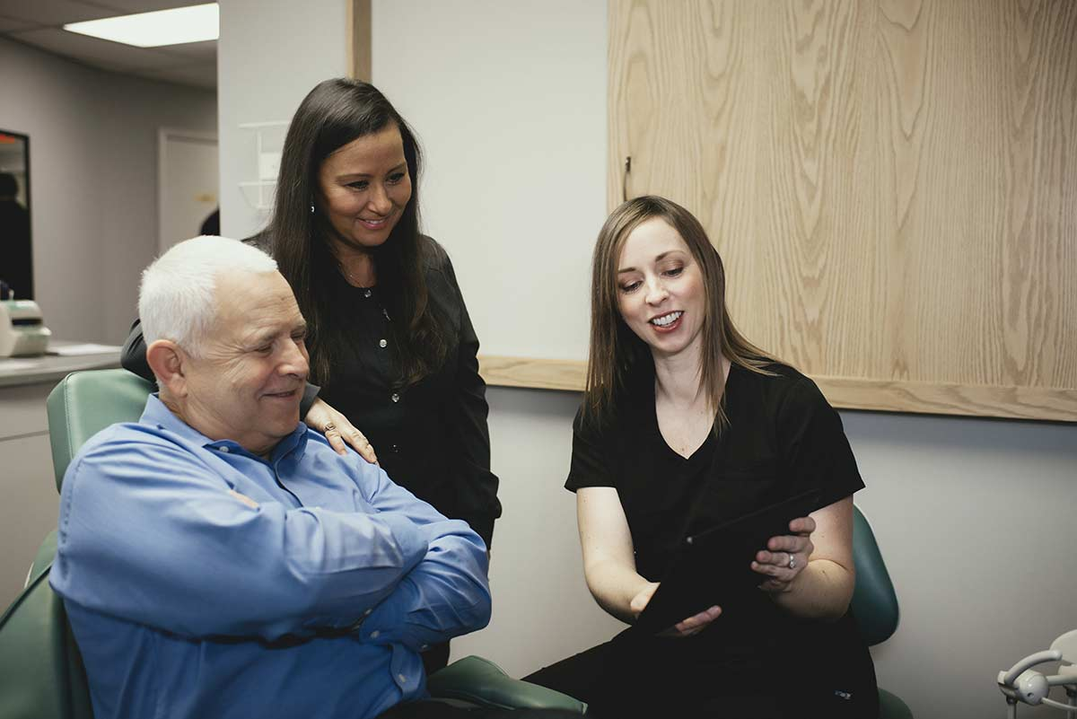 Photo of Dr. Binz showing a patient information on a tablet