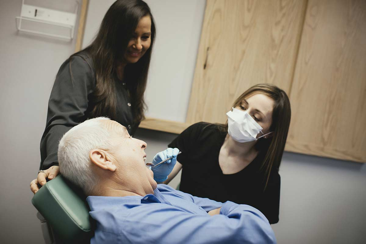 Photo of Dr. Binz with a patient in the dental chair