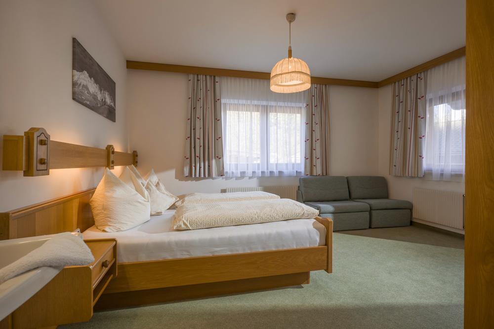 Auermühle Appartements – Schlafraum