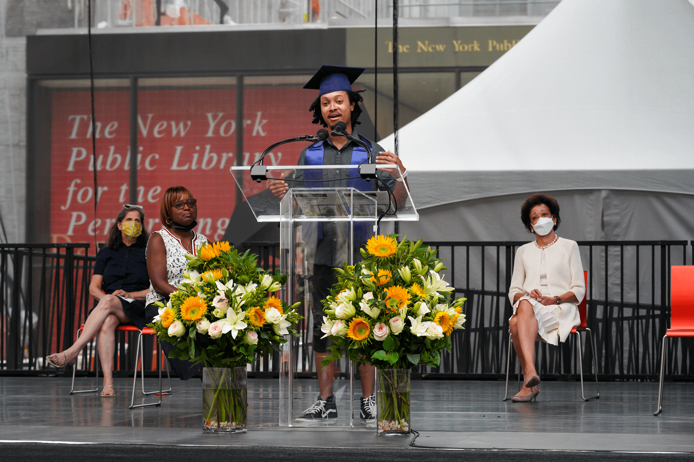 Student giving a speech on graduation stage