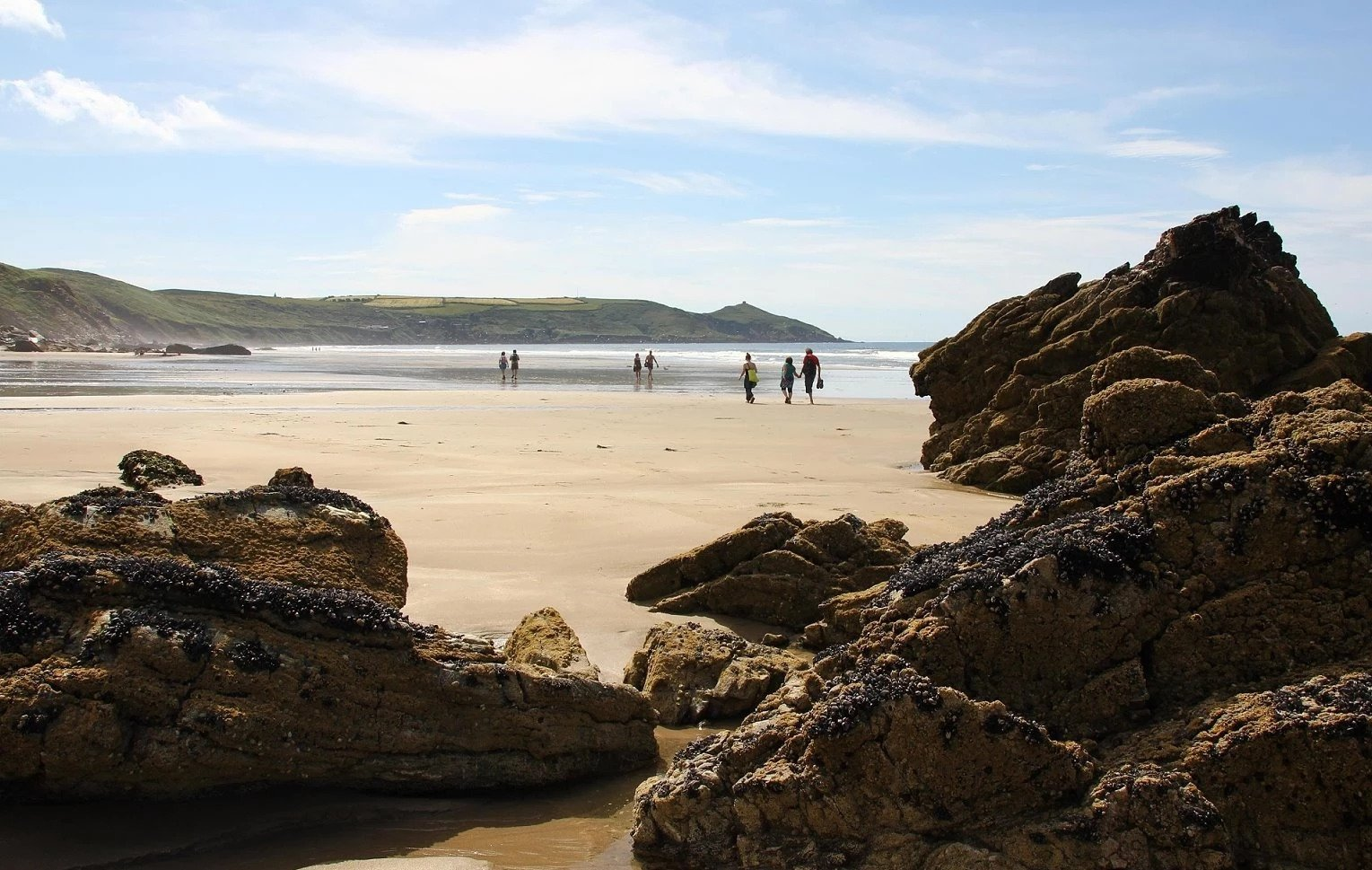 People strolling along one of Maker with Rame's golden sandy beaches at Whitsand Bay