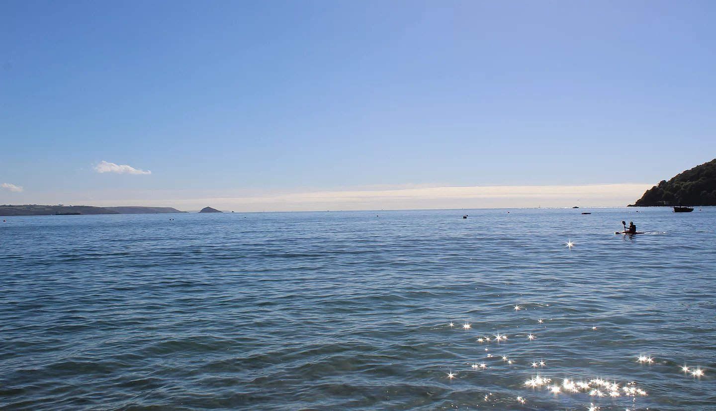A kayaker on the water at Kingsand Beach