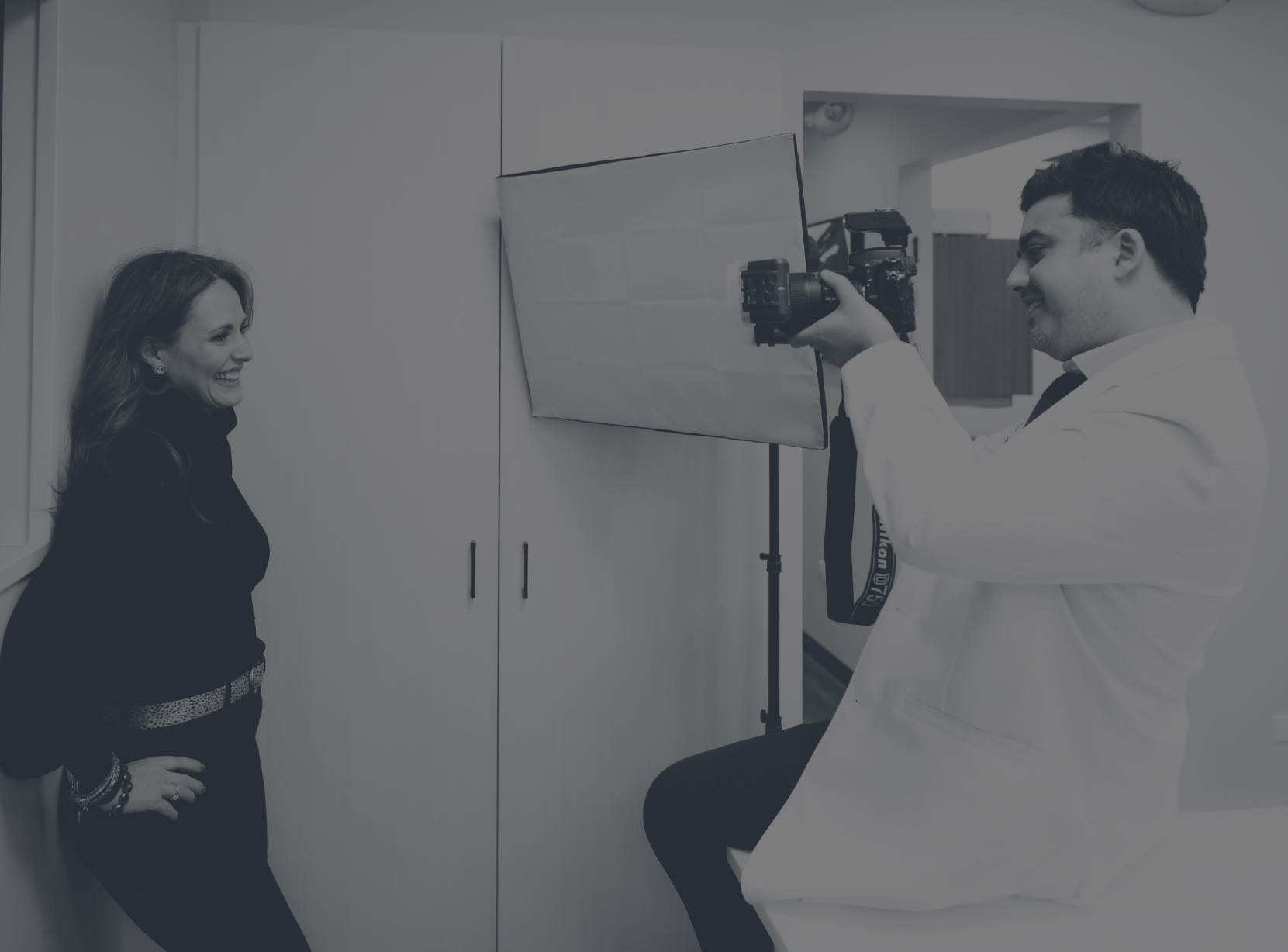 Dr. Sushant taking a photo of a smiling patient