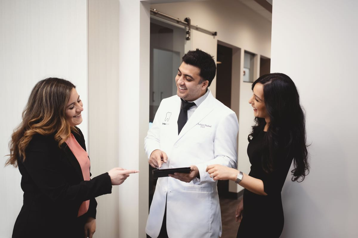 Photo of Dr. Sushant and Dr. Ritu reviewing information with a patient