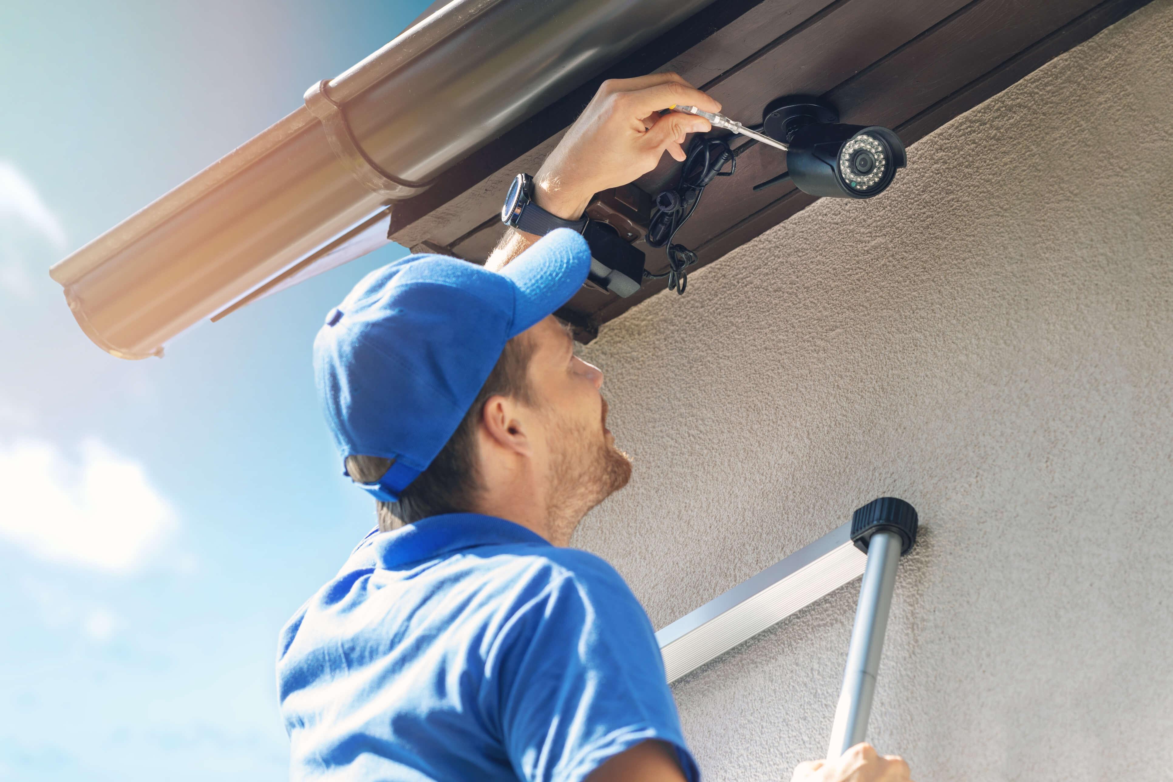 Turnip technician installing smart home security camera.