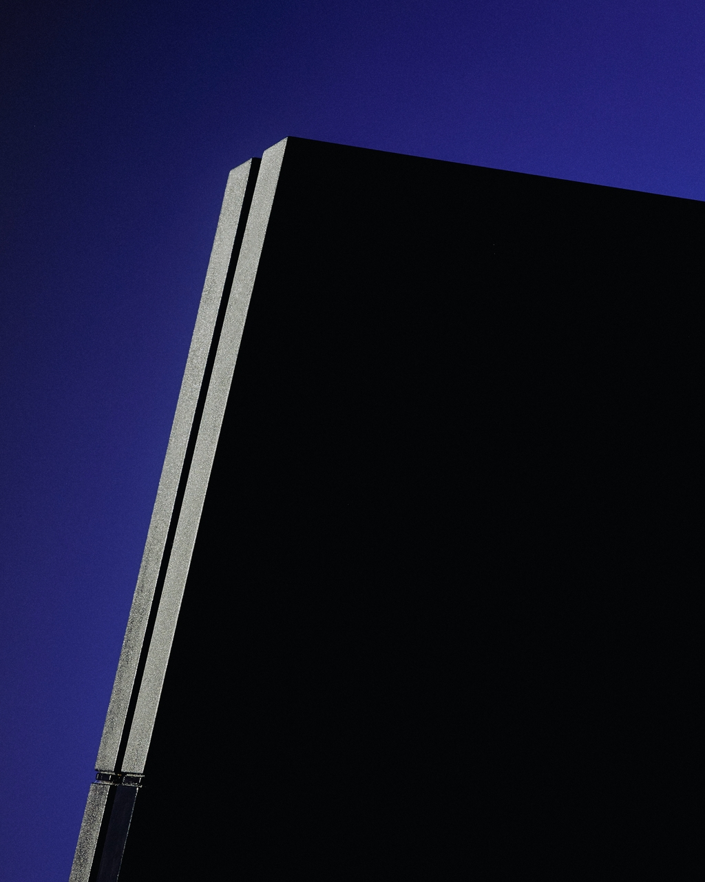Shot of a hard drive with a dark blue backdrop.