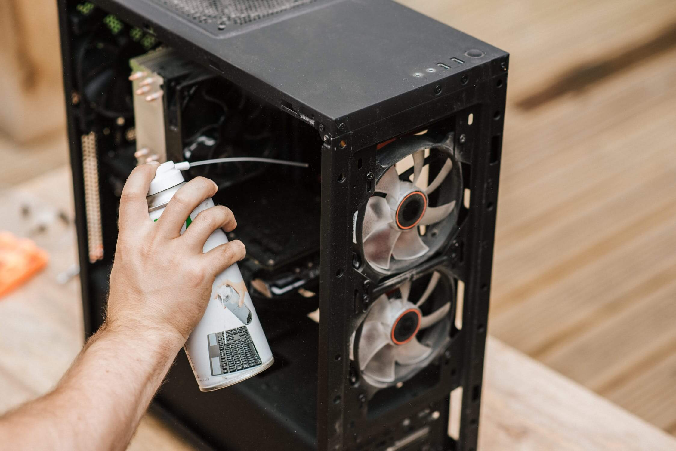 Using Compressed Air to clean a Motherboard