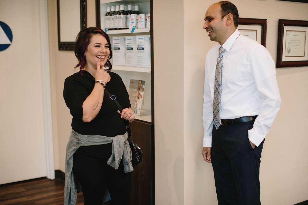 Photo of Dr. Purvak Parikh with a patient