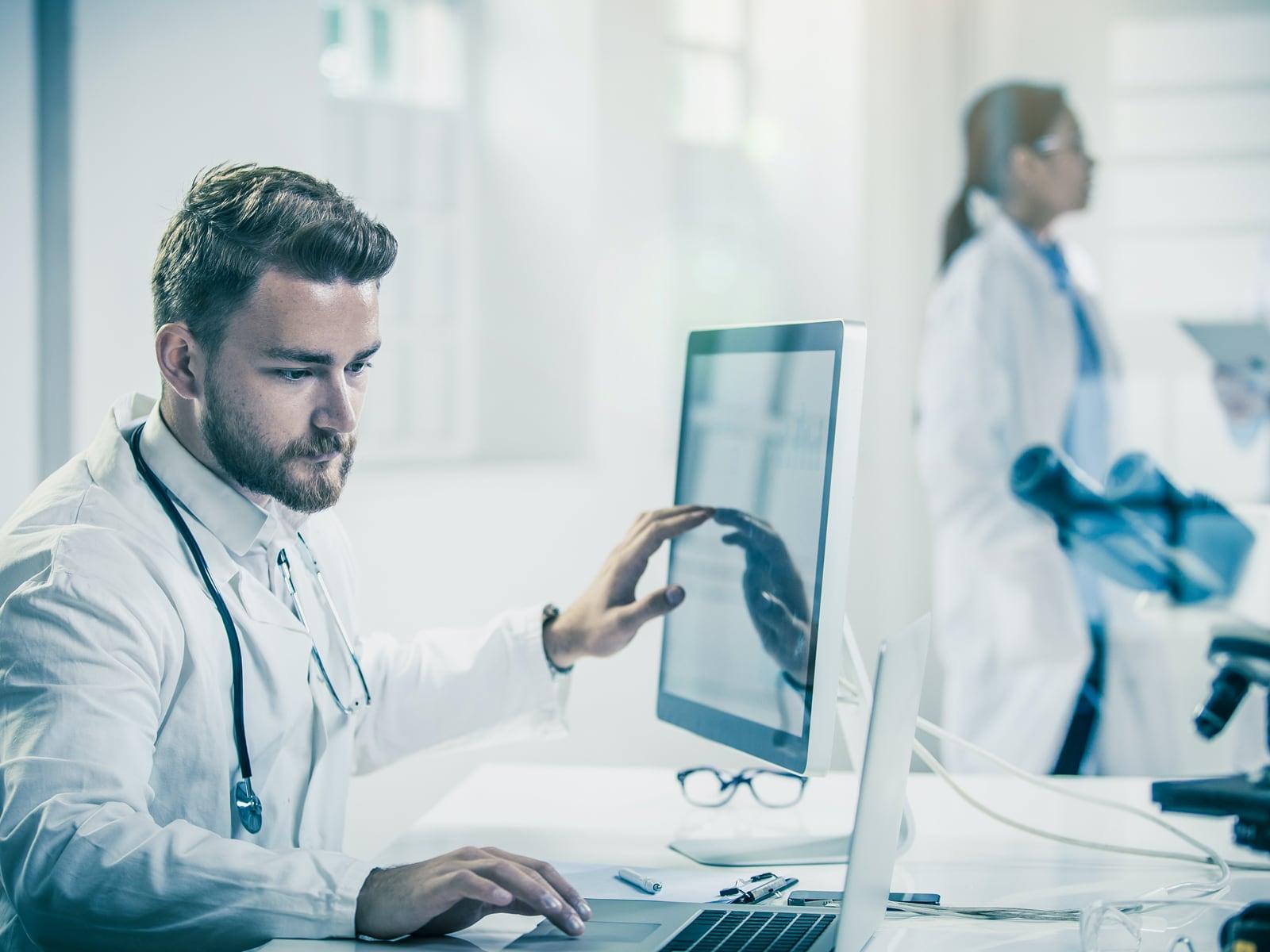 Doctor looking at desktop screen