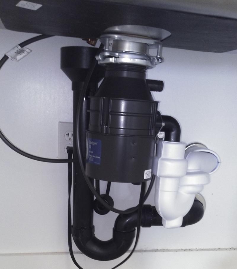 A garbage disposal under a sink
