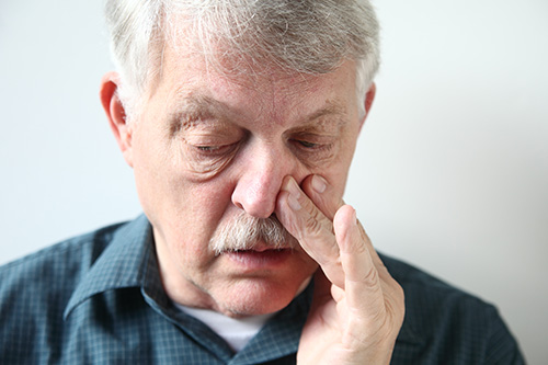 Runny nose is a common allergy symptom, along with facial pain