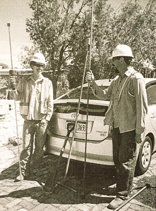 Vintage image of UTS Soiltec standing in front of Toyota Prius