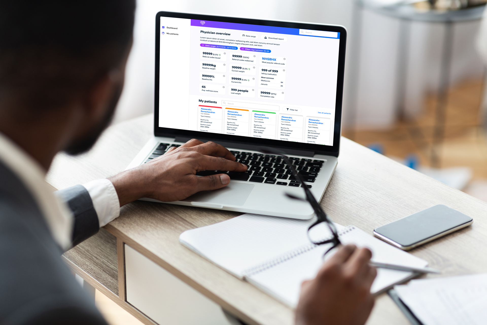 Man in a suit using the Gro Clinical Dashboard