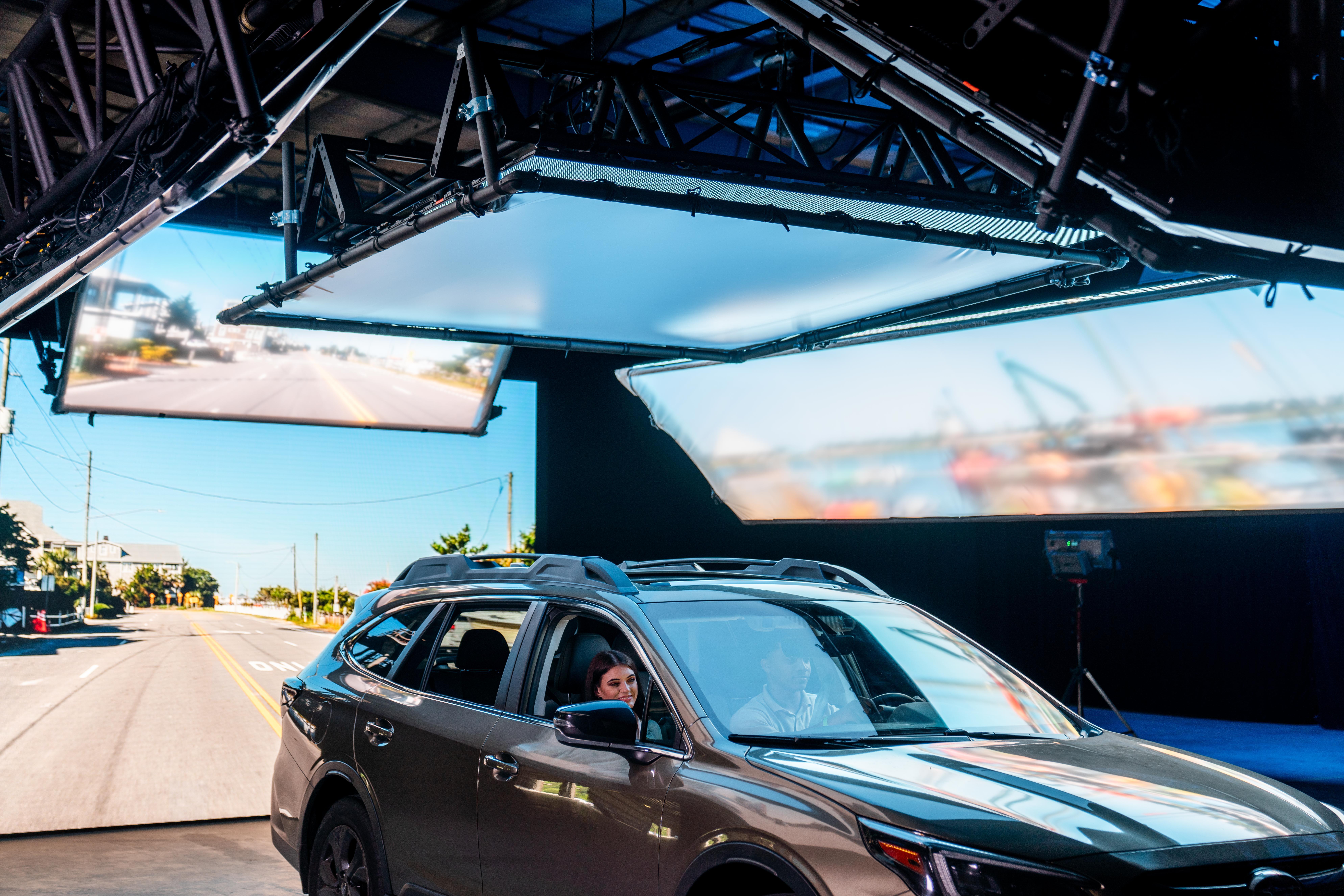 Car being filmed on movie studio set.