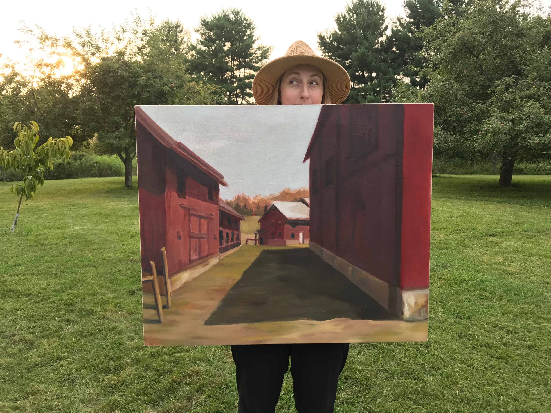 "Amanda Penecale holding her painting ""Muscoot Farm in Katonah"""
