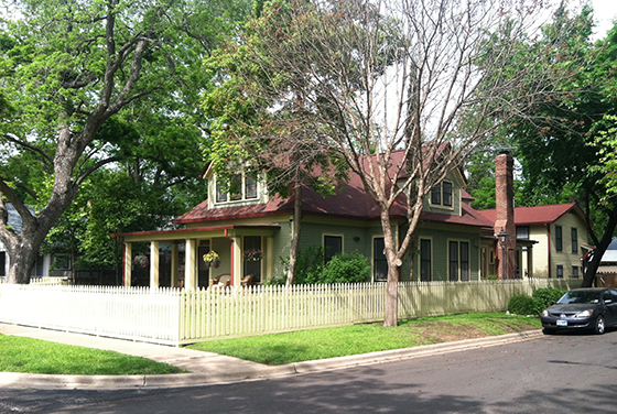This is a classic. Very Austin, farm house style, large porch, picket fence.