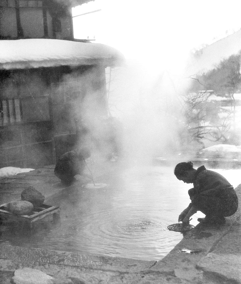 Woman washing clothes at the onsen