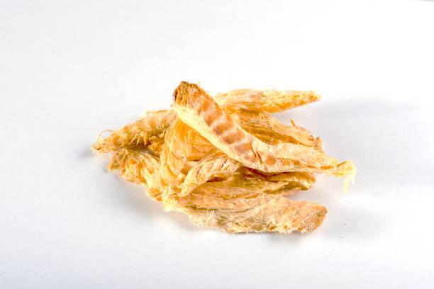 Dried pollock on white dried fish dog treats