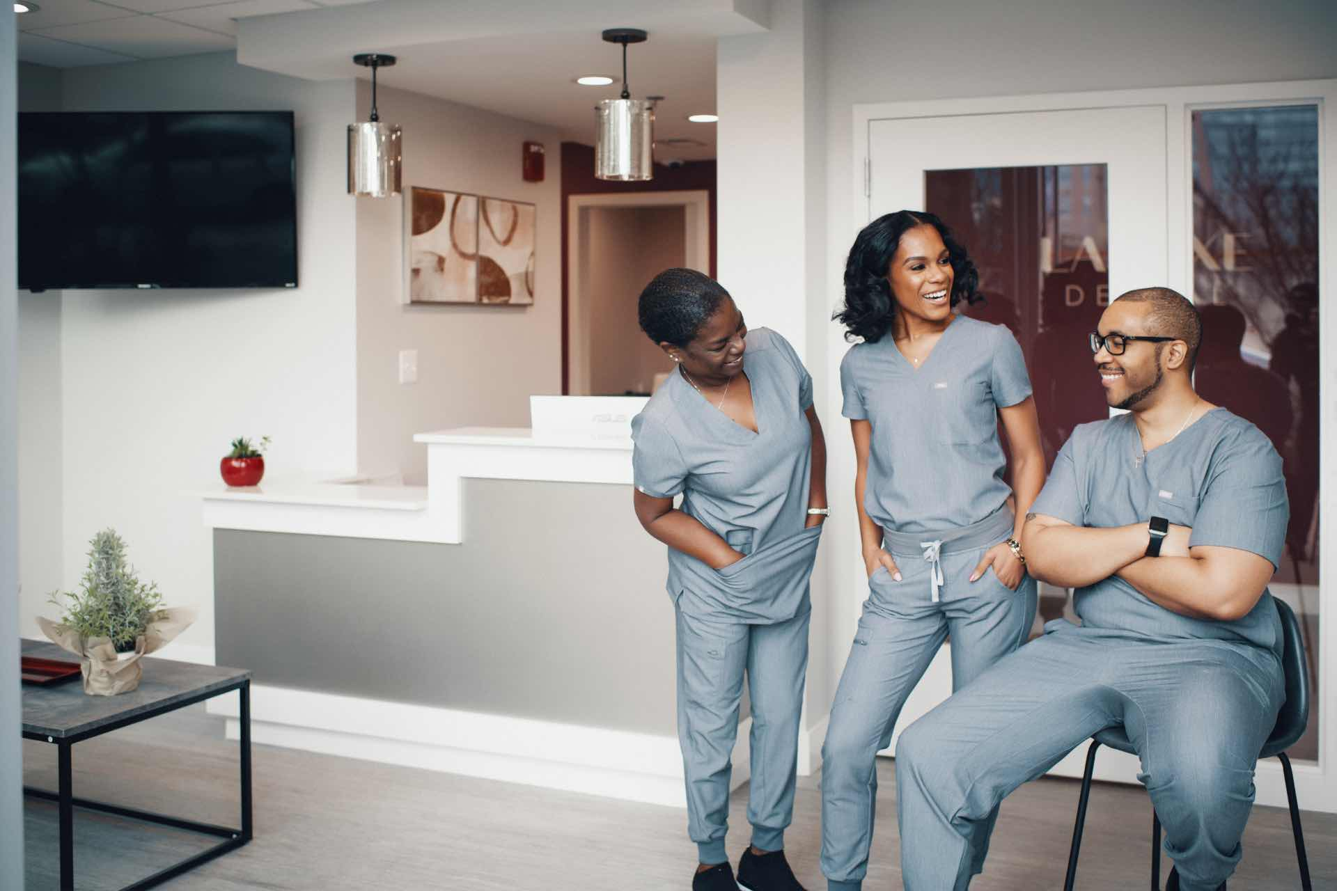 Photo of the La Luxe Dental team smiling