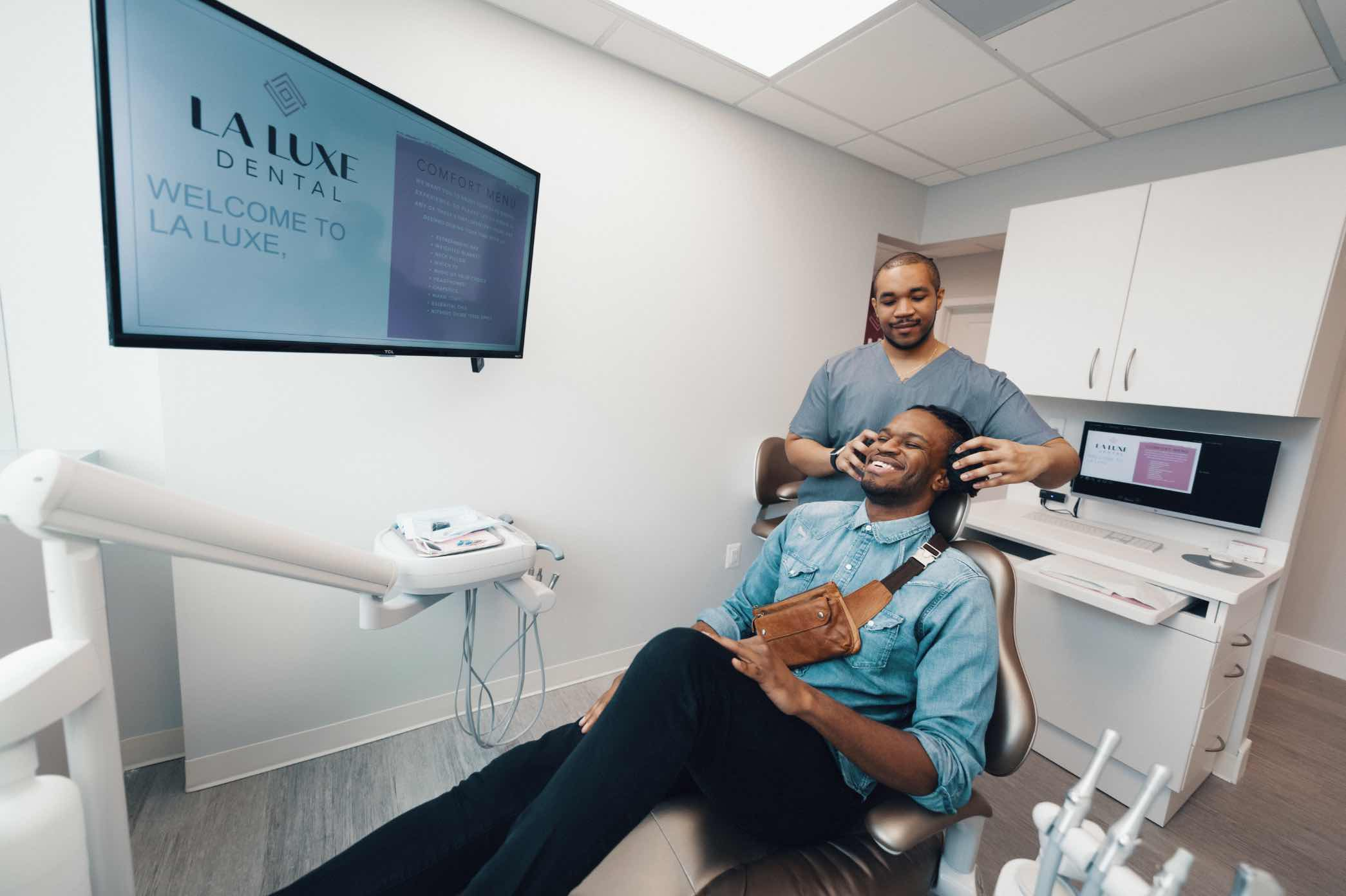 Photo of a team member with a patient in a dental chair