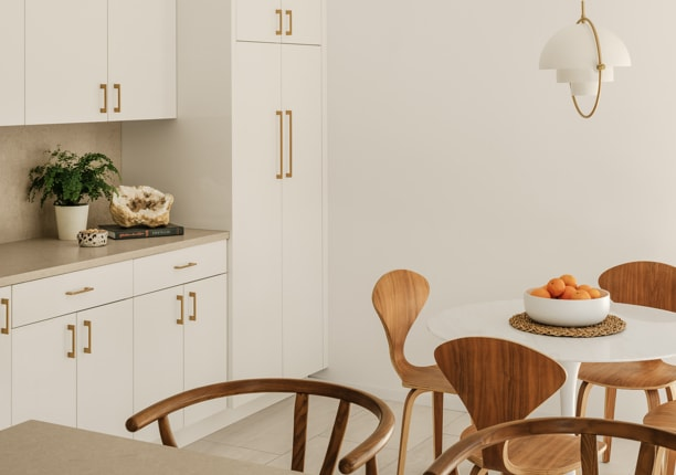 White kitchen with wooden retro-style chairs