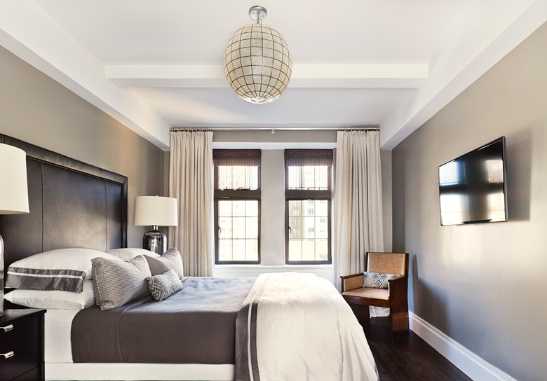 Bedroom with globe-like light fixture