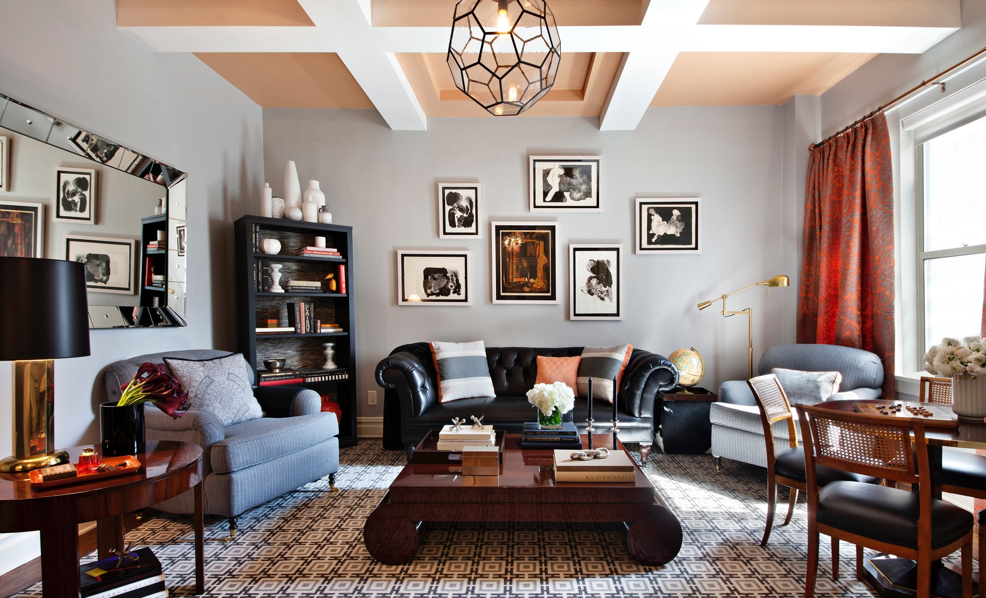 Elegant living room with geometrical light fixture and gallery wall