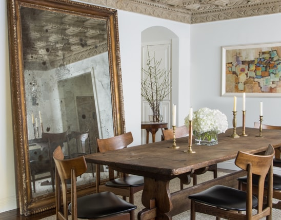 Dining room table with large floor mirror