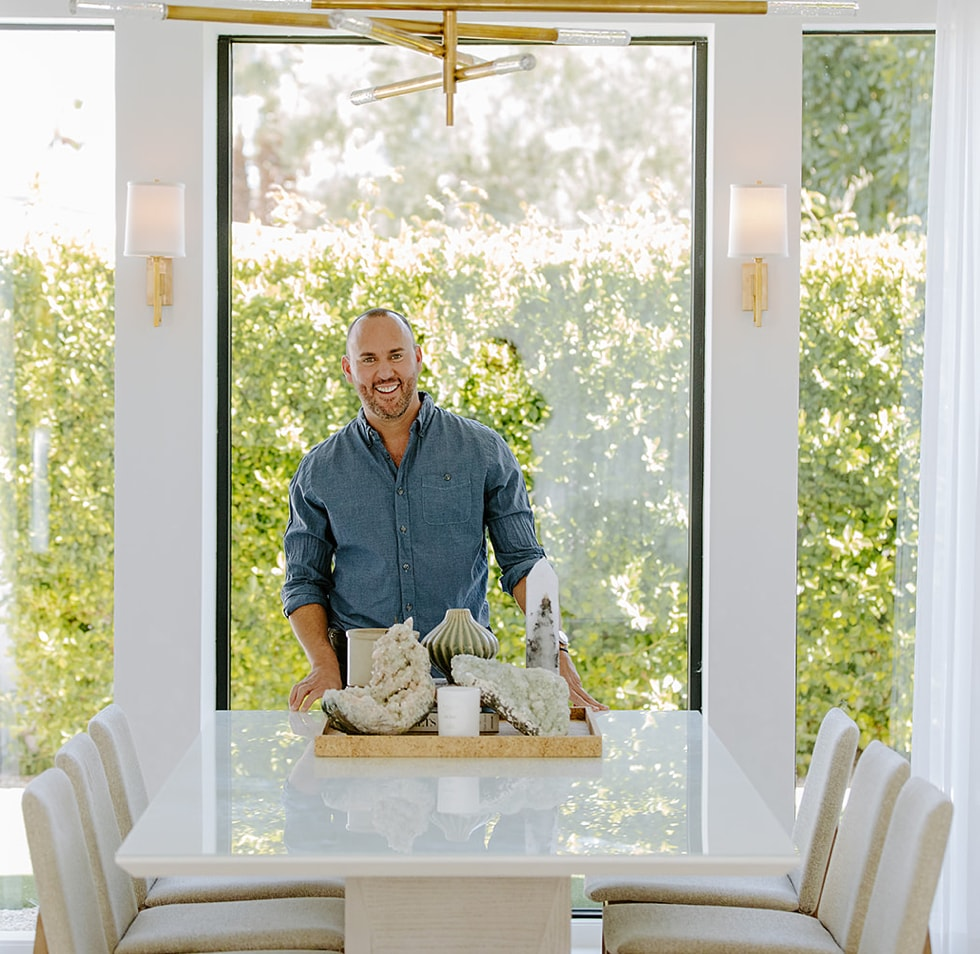 Joshua Smith standing behind dining room table