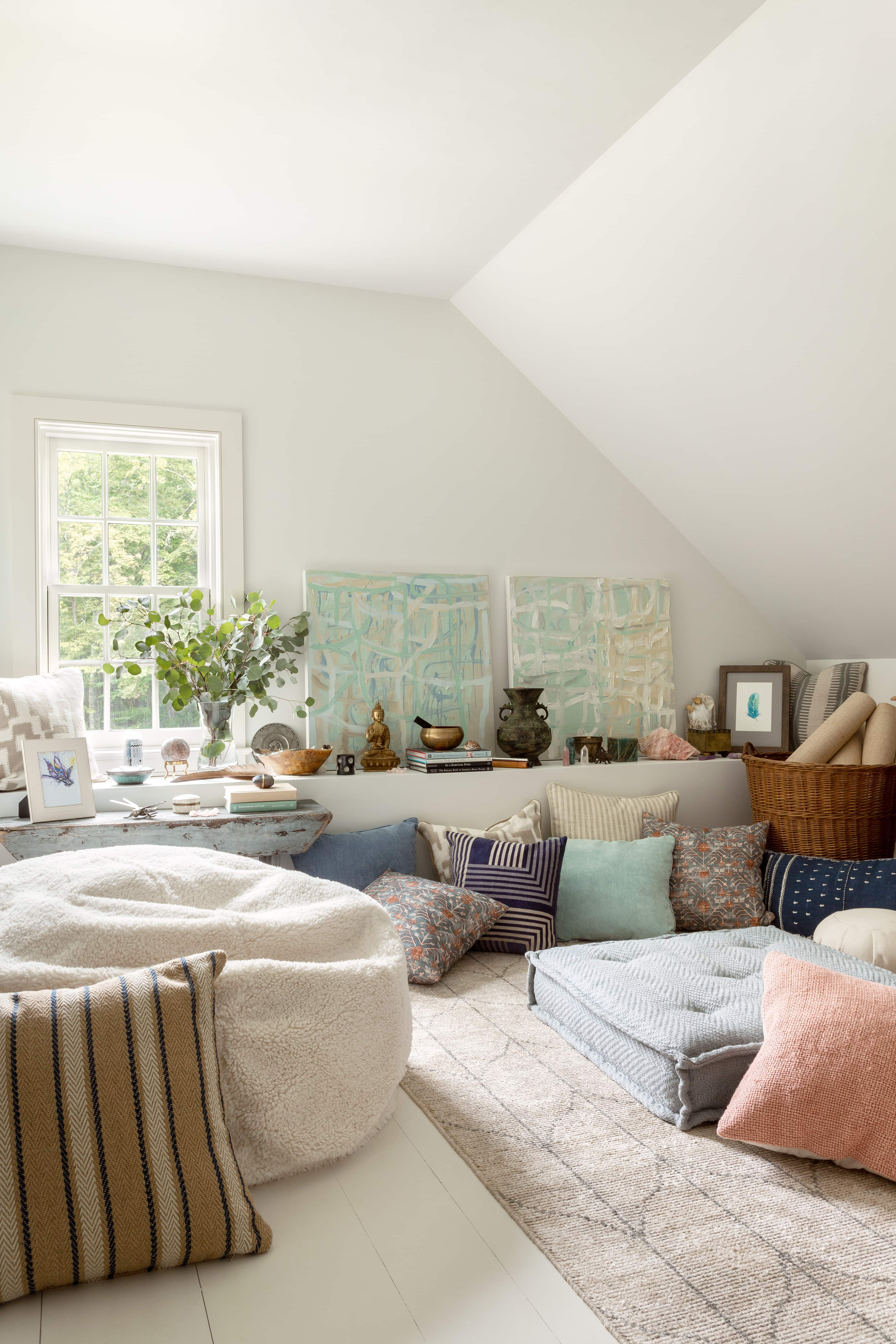 Litchfield County loft with white walls and pillows on floor