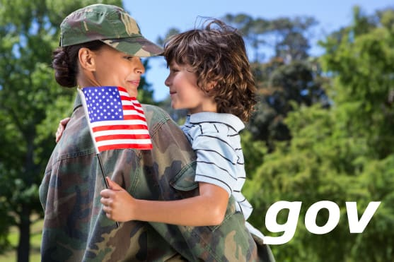 Veteran woman holding her son with a USA flag