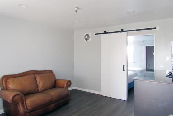 Double queen suite resting area - sofa and mini-refrigerator