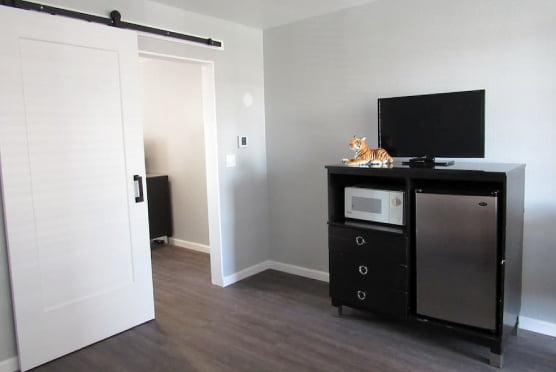 Double Queen suite resting area - TV, mini-fridge and microwave