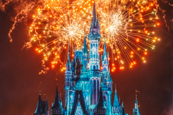 Disney castle with fireworks in the back