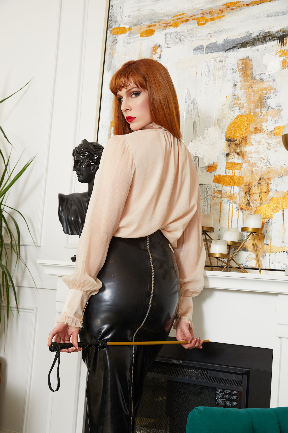 Miss Lila Sage in black latex