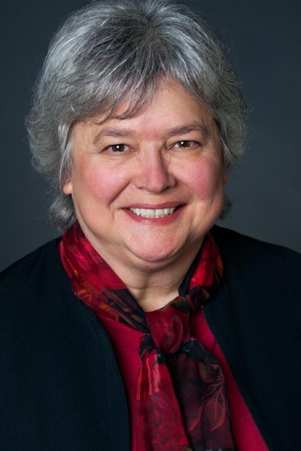 A headshot of Susan M.