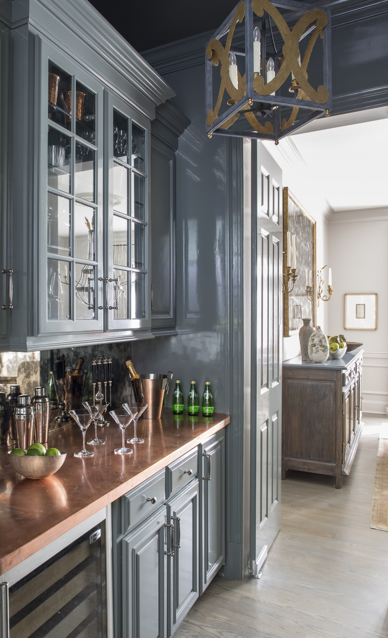 Kitchen with blue-grey cabinetry and copper countertops.