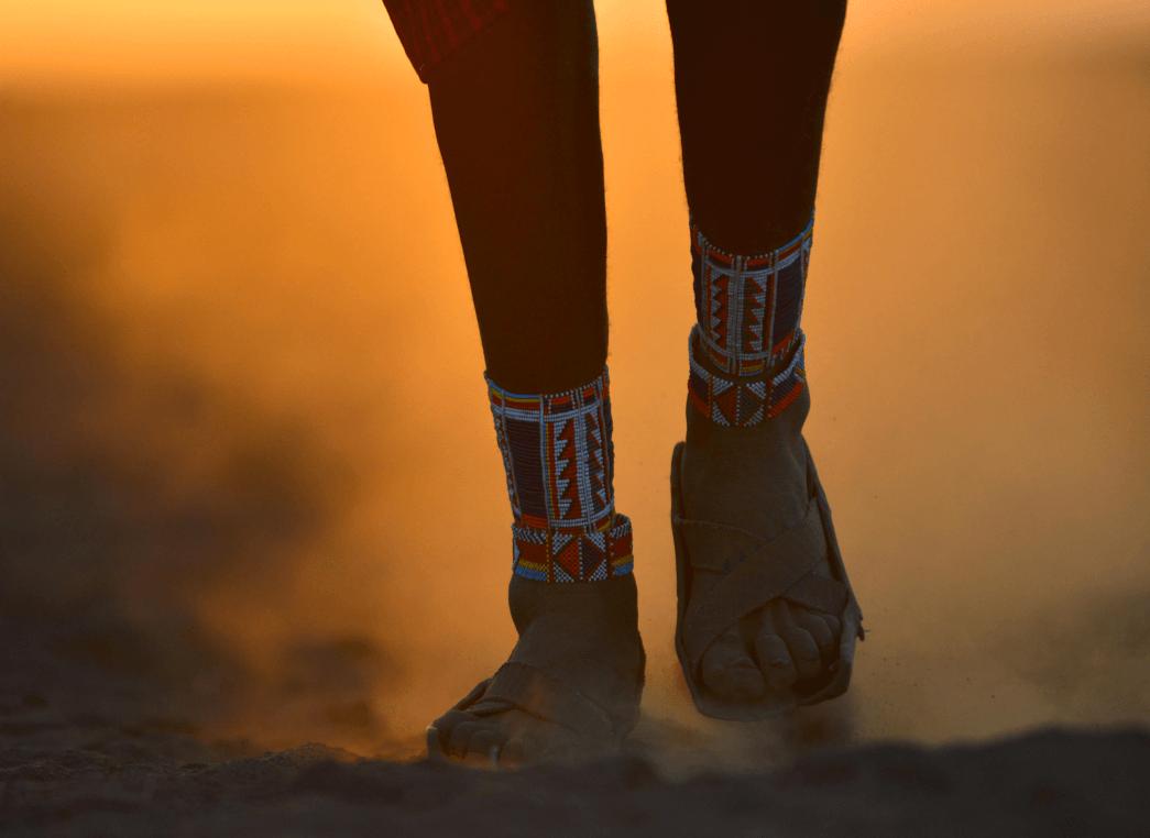 feet of a man on dust