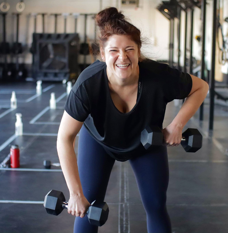 Happy woman working out at Junction Fitness