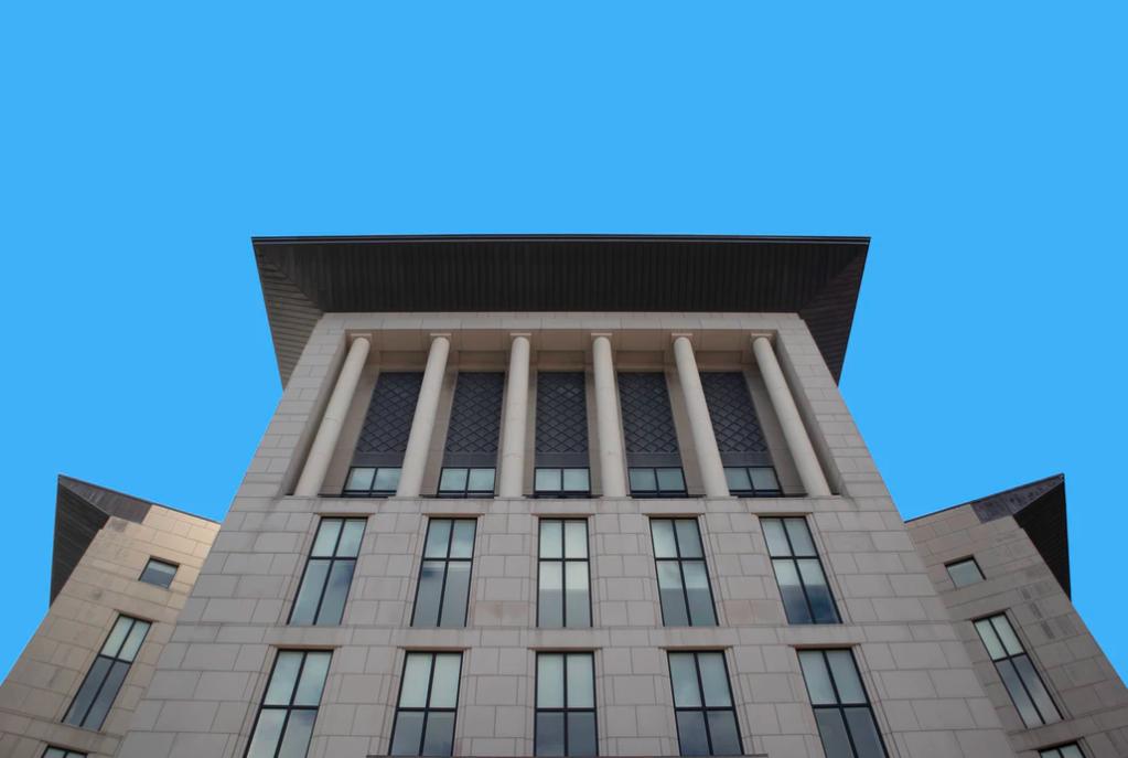 White concrete office building under blue sky