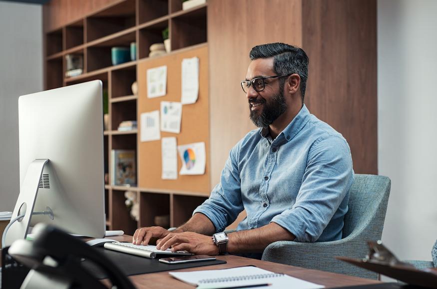 Professional man smiling user computer