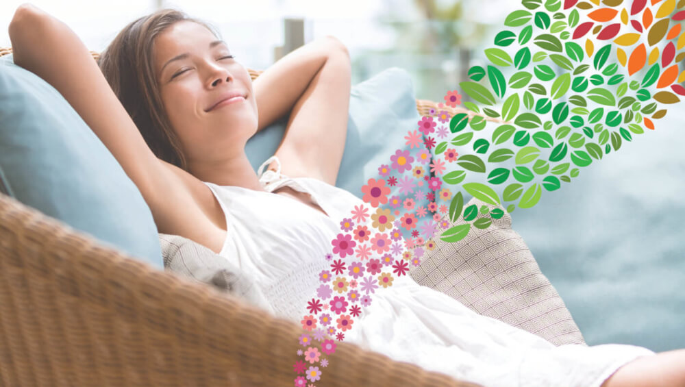 woman on chair outside with seasonal leaves and flowers demonstrating buguard blend being released
