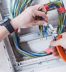 A worker fixing electrical wires