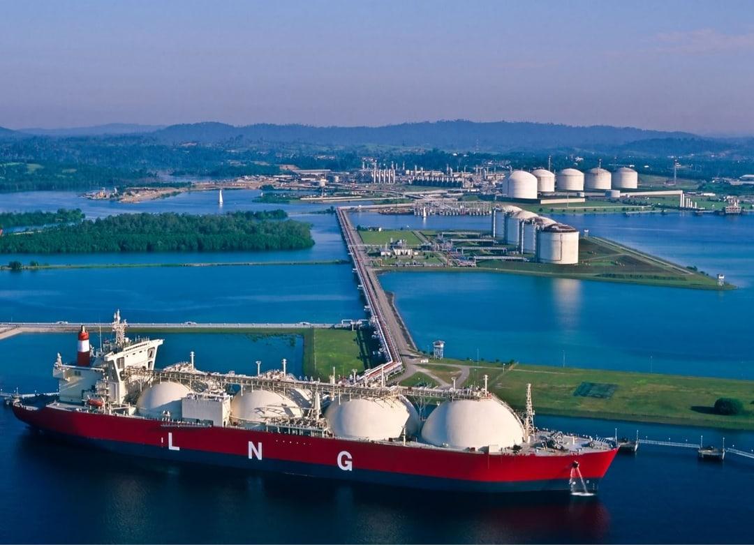 An LNG carrier at an export terminal