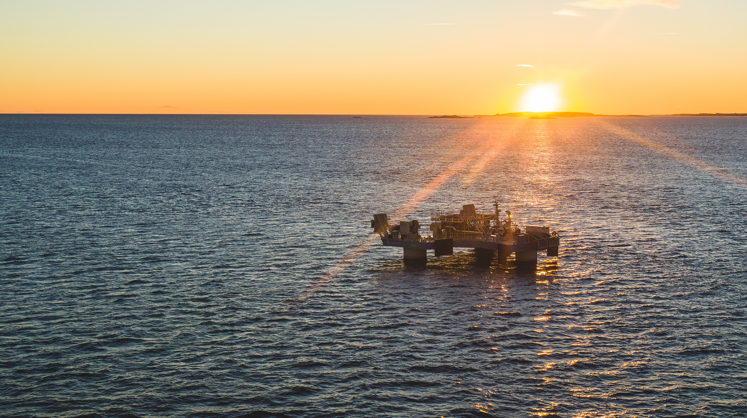 Floating lng transfer system in sunset
